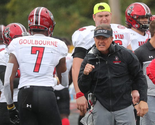 Austin Peay head coach Mark Hudspeth congratulates his defense as it comes off the field during their OVC game against Tennessee Tech Saturday Oct. 26, 2019 in Cookeville.