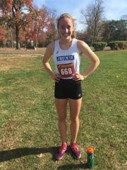 Metuchen's Caroline Schleif after winning the 2019 GMC Cross Country Championship.