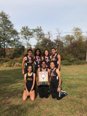 The South Brunswick girls cross country team after winning the 2019 GMC title