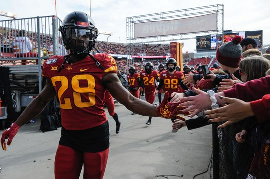 Oct 26, 2019; Ames, IA, USA; Iowa State Cyclones running back Breece Hall (28) greets fans as he runs off the field before the game against the Oklahoma State Cowboys at Jack Trice Stadium.