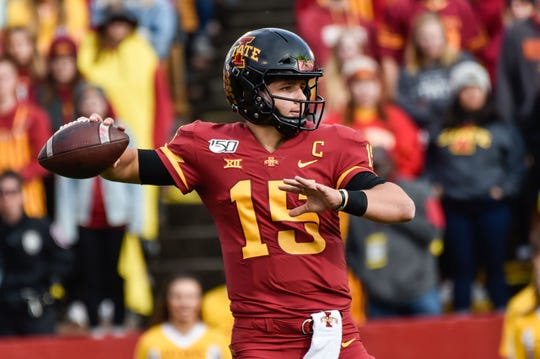 Iowa State Cyclones quarterback Brock Purdy (15) throws a pass against the Oklahoma State Cowboys during the first quarter at Jack Trice Stadium.