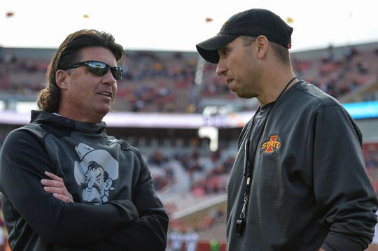 Oct 26, 2019; Ames, IA, USA; Oklahoma State Cowboys head coach Mike Gundy (left) and Iowa State Cyclones head coach Matt Campbell (right) talk before the game at Jack Trice Stadium.