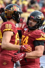 Oct 26, 2019; Ames, IA, USA; Iowa State Cyclones offensive lineman Bryce Meeker (74) reacts with tight end Charlie Kolar (88) after Kolar caught an 18 yard touchdown pass from quarterback Brock Purdy (15) against the Oklahoma State Cowboys during the second quarter at Jack Trice Stadium.