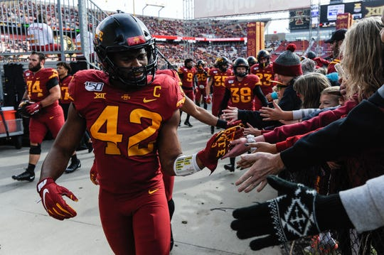 Oct 26, 2019; Ames, IA, USA; Iowa State Cyclones linebacker Marcel Spears Jr. (42) greets fans before the game against the Oklahoma State Cowboys at Jack Trice Stadium.