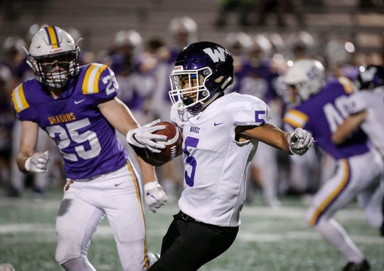 Waukee junior running back Aaron Smith carries the ball against Johnston on Friday, Oct. 25, 2019, in Johnston.