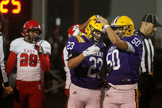 Indianola sophomore Kael Kolarik is congratulated by senior Miles Berg after scoring a touchdown. Indianola hosted Des Moines East on senior night Oct. 25.