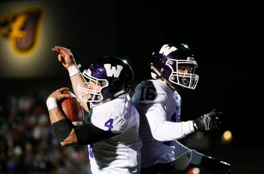 Waukee senior quarterback Mitch Randall, left, celebrates a touchdown with teammate Sam O'Dell on Friday, Oct. 25, 2019, in Johnston.