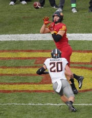 Iowa State tight end Charlie Kolar, top, pulls in a touchdown reception over Oklahoma State safety Malcolm Rodriguez during the first half of an NCAA college football game, Saturday, Oct. 26, 2019, in Ames, Iowa.