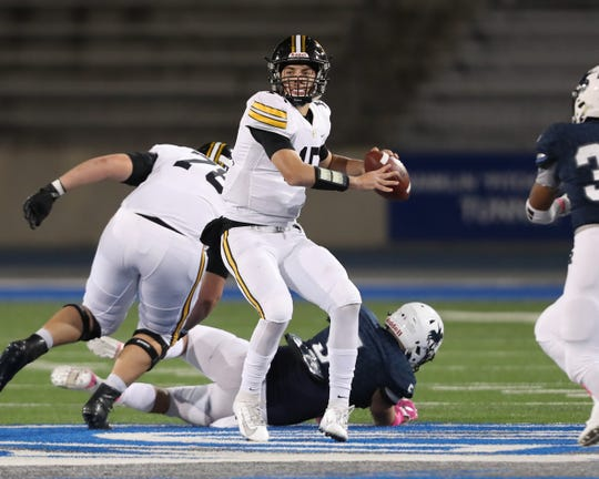 Oct 25, 2019; Des Moines, IA, USA; Southeast Polk Rams Jaxon Dailey (15) throws a pass against the Des Moines Roosevelt Riders at Drake Stadium.
