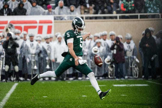 Michigan State punter Jake Hartbarger punts the ball against Penn State during the first half at Spartan Stadium in East Lansing, Saturday, October 26, 2019.