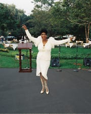 Aretha Franklin poses outside her home.