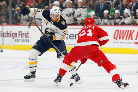 Buffalo Sabres center Jeff Skinner (53) tries to take the puck past Detroit Red Wings center Valtteri Filppula (51) in the first period of an NHL hockey game Friday, Oct. 25, 2019, in Detroit.