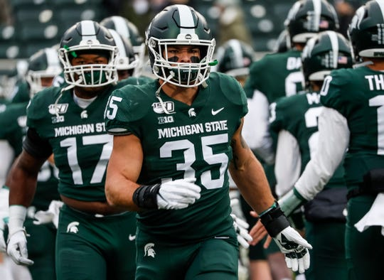 Michigan State linebacker Joe Bachie warms up before the Penn State game at Spartan Stadium in East Lansing, Saturday, October 26, 2019.