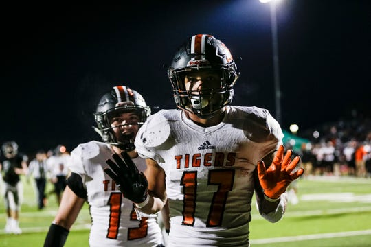 Belleville's Jamari Buddin scores a touchdown against Plymouth during the second half of Belleville's 41-14 win on Friday, Oct. 25, 2019, in Canton.