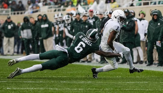 Michigan State safety David Dowell tries to stop Penn State wide receiver KJ Hamler during the first half at Spartan Stadium in East Lansing, Saturday, October 26, 2019.