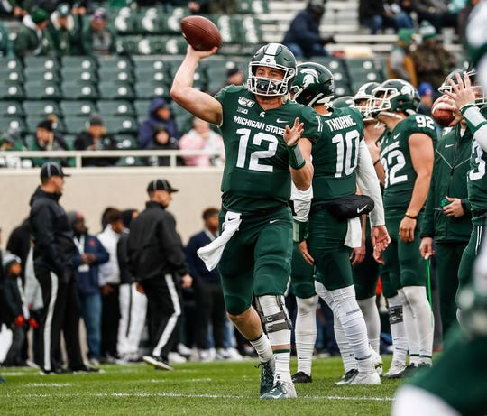 Michigan State quarterback Rocky Lombardi passes before the Penn State game at Spartan Stadium in East Lansing, Saturday, October 26, 2019.