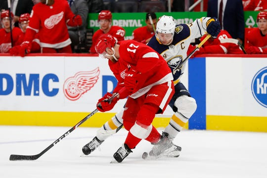 Detroit Red Wings defenseman Filip Hronek (17) defends against Buffalo Sabres center Jack Eichel (9) in the third period of an NHL hockey game Friday, Oct. 25, 2019, in Detroit.