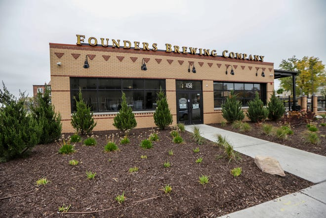 A sign is placed outside of the Founders Brewing Company in Detroit, alerting patrons they are temporarily closed on Saturday, Oct. 26, 2019.