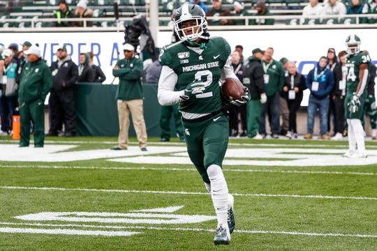 Michigan State wide receiver Julian Barnett warms up before the Penn State game at Spartan Stadium in East Lansing, Saturday, October 26, 2019.