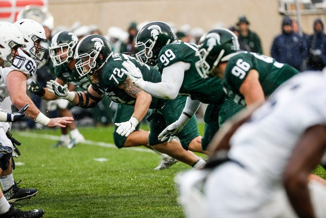 Michigan State defensive tackle Mike Panasiuk (72) and defensive tackle Raequan Williams (99) will line up together one last time at Spartan Stadium. The pair has been a force over the last few seasons for the Spartans.