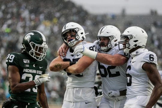 Penn State's Pat Freiermuth celebrates a touchdown against Michigan State during the first half at Spartan Stadium on Saturday.