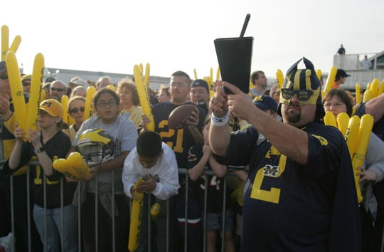 "Jeff Holzhausen chanted ""Go Blue"" along with hundreds of fans during a rally for the 2006 Rose Bowl game at Santa Monica Pier."