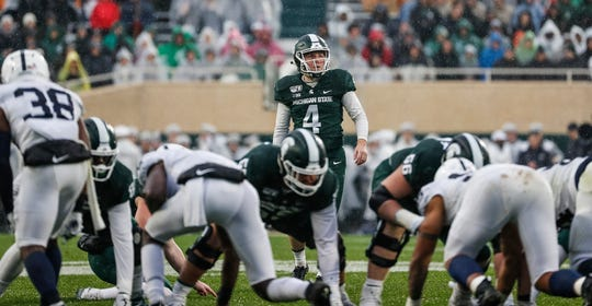 Michigan State place kicker Matt Coghlin (4) looks before attempting a field goal against Penn State during the first half at Spartan Stadium in East Lansing, Saturday, October 26, 2019.