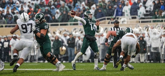 Michigan State quarterback Brian Lewerke makes a pass against Penn State during the first half at Spartan Stadium in East Lansing, Saturday, October 26, 2019.