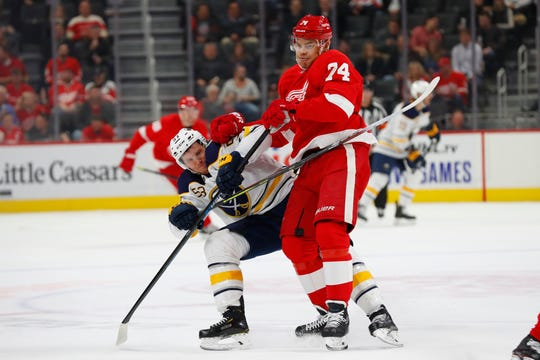 Detroit Red Wings defenseman Madison Bowey (74) checks Buffalo Sabres center Jeff Skinner (53) off the puck in the first period of an NHL hockey game Friday, Oct. 25, 2019, in Detroit.
