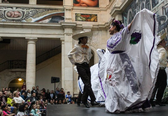 Traditional Mexican dresses flutter during a performance by Ballet Folklorico De Detroit at the Detroit Institute of Arts, Saturday, Oct. 26, 2019. Pairs often break off and dance together then converge back into the group.