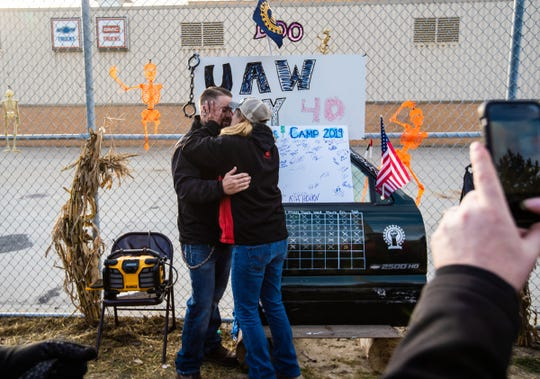 UAW Local 598 members celebrate outside of Flint Assembly after UAW ratified their contract with General Motors marking the end of the strike on Friday, October 25, 2019.