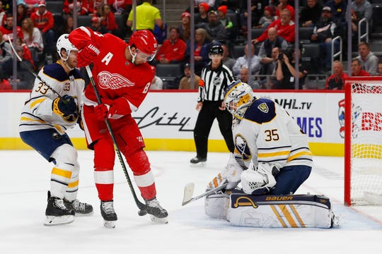 Buffalo Sabres goaltender Linus Ullmark (35) stops a shot by Detroit Red Wings center Frans Nielsen (81) in the second period of an NHL hockey game Friday, Oct. 25, 2019, in Detroit.