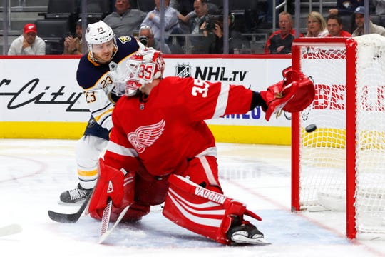 Buffalo Sabres center Sam Reinhart (23) scores against Detroit Red Wings goaltender Jimmy Howard (35) in the third period of an NHL hockey game Friday, Oct. 25, 2019, in Detroit.