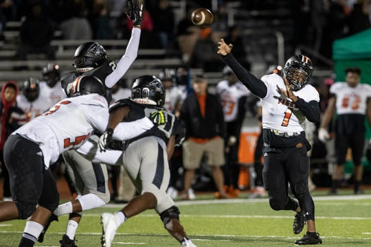 Belleville quarterback Christian Dhue-Reid (1) makes a pass against Plymouth during the first half at Plymouth-Canton Educational Park in Canton, Friday, Oct. 25, 2019.