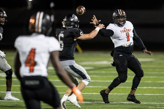 Belleville quarterback Christian Dhue-Reid makes a pass against Plymouth during the first half of Belleville's 41-14 win on Friday, Oct. 25, 2019, in Canton.