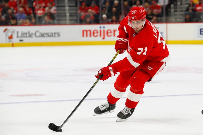 Red Wings center Dylan Larkin moves the puck against the Sabres on Friday night.