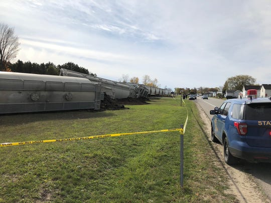 Heavy equipment will be needed to remove the train. Lake Street east of U.S. 131 will likely be closed for several days until the clean up efforts are complete.