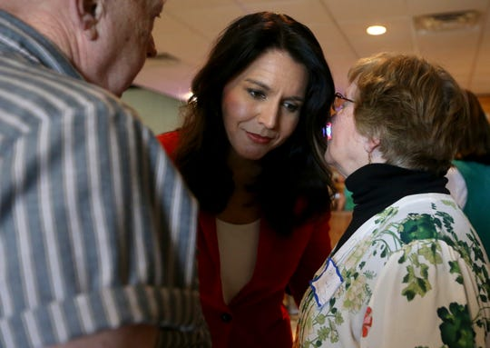 Democratic presidential candidate U.S. Rep. Tulsi Gabbard, D-Hawaii, listens to Betty Lord-Dinan, of the Clayton County Democrats, during the Iowa Democrats' Passport to Victory event at Johnson's Supper Club in Elkader, Iowa, Sunday, Oct. 20, 2019.