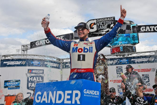 Todd Gilliland (4) celebrates winning the NASCAR Truck Series race Saturday at Martinsville Speedway in Martinsville, Va.