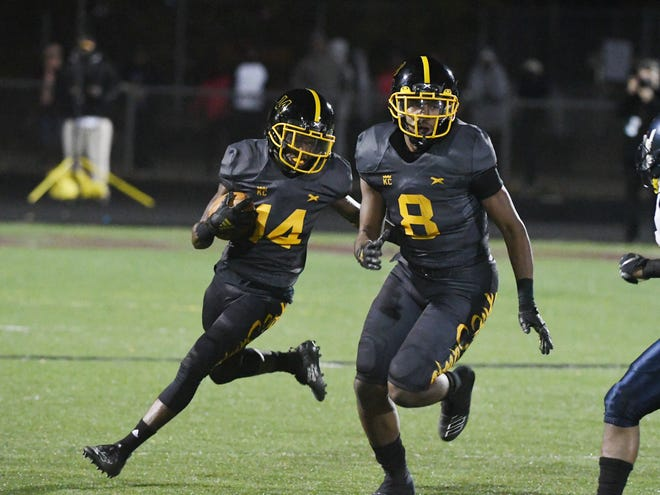 Detroit King's Peny Boone blocks for Rahiim Mersier on a run in the first quarter on Friday.