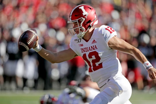 Indiana quarterback Peyton Ramsey (12) reaches with the ball to score a touchdown during the first half Saturday against Nebraska.