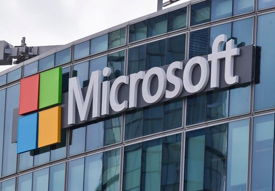 FILE - This April 12, 2016 file photo shows the Microsoft logo in Issy-les-Moulineaux, outside Paris, France. The Pentagon has awarded Microsoft a $10 billion cloud computing contract called JEDI, Friday, Oct. 25, 2019. The contentious bidding process for the contract pitted Microsoft, Amazon and Oracle, among others, against one another.