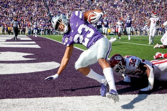 Kansas State wide receiver Joshua Youngblood scores a touchdown against Oklahoma safety Delarrin Turner-Yell during the first half.