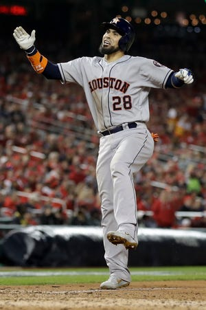 Houston Astros' Robinson Chirinos celebrates after his home run against the Washington Nationals during the sixth inning on Friday.
