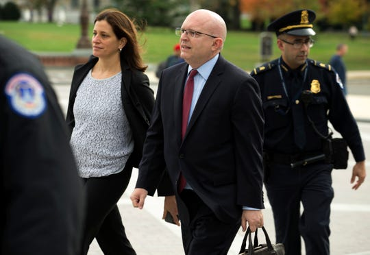 Philip Reeker, center, acting assistant secretary of state for Europe, arrives to the Capitol for closed door interview at the Capitol in Washington, Saturday, Oct. 26, 2019.