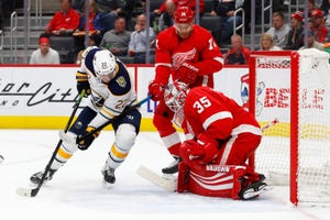 Red Wings goaltender Jimmy Howard (35) stops a shot by Sabres left wing Johan Larsson (22) in the first period on Friday.