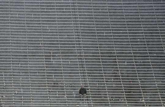 A lone fan sits in the empty student section as the rain continued throughout the 28-7 Penn State victory over Michigan State.