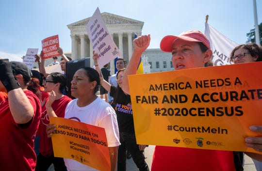Demonstrators gather June 27 at the Supreme Court as the justices finish the term with key decisions on gerrymandering and a census case involving an attempt by the Trump administration to ask everyone about their citizenship status in the 2020 census, on Capitol Hill in Washington.