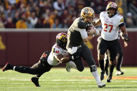 Minnesota quarterback Tanner Morgan (2) runs with the ball against Maryland defensive back Antoine Brooks Jr. (25) Saturday in the Gophers' 52-10 rout.