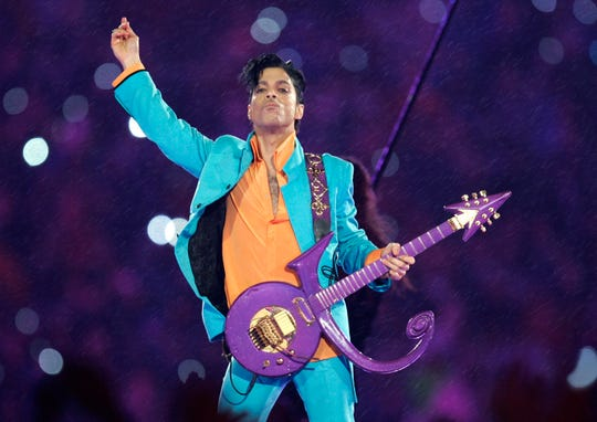 Prince performs Feb. 4, 2007, during the halftime show at Super Bowl XLI in Miami.